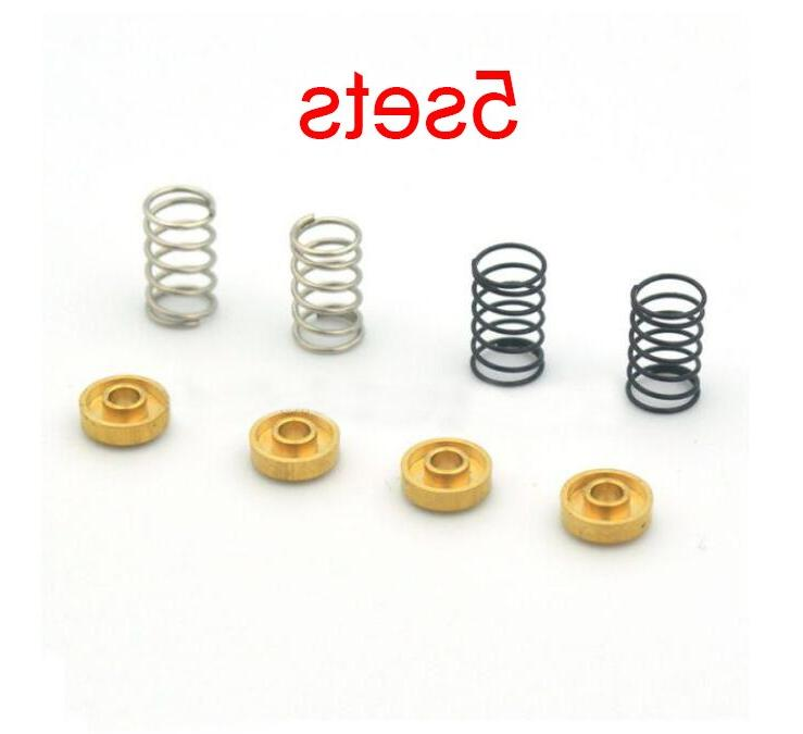 5 sets black silver springs with brass